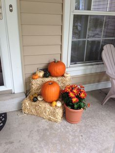 Fall front porch decor with hay bales and pumpkins