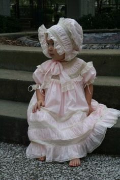 Round yoke heirloom dress with puffing and Charleston bonnet. Look at the detail in the bonnet ties.