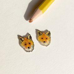 Tiny earstuds drawn on shrink plastic
