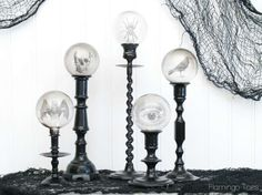 Spooky Candlestick Display made with clear ornaments and spooky images printed on transparency film