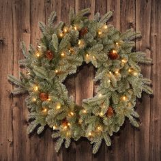 Feel Real® Frosted Arctic Spruce Wreath with 50 Clear Lights