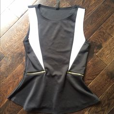Chic Peplum Top Super cute! Great to wear to work, dates, etc. basically brand new, I have only worn it once. No trades. Bundle to save even more. Not sure brand. High quality Tops Tank Tops