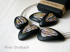 Polymer clay necklace with Stroppel cane pattern by Alina Strekach.