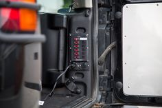 Installing a west marine circuit breaker panel to the rear of the vehicle to run components off a second battery.