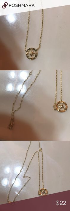 Gold Compass Necklace Dainty and beautiful gold compass necklace, comes with a box for shipping purposes and is like new condition  Gold plated I think!  Had it for awhile no tarnish in perfect shape with a diamond in the middle Jewelry Necklaces
