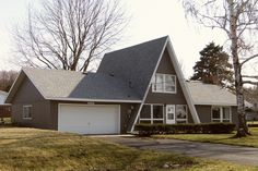 ideenreich Gray a-frame with garage and addition. Onekama, MI How to Budget for Home Improvem Roof Styles, House Styles, A Frame Cabin Plans, Pole Barn Plans, A Frame Tent, Pole Barn Homes, Forest House, Home Additions, The Ranch