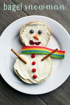 This quick and easy food art is sure to bring smiles to snack time this winter. This Bagel Snowman recipe is fun for the kids and easy on the parents. All you'll need are bagels, cream cheese, pretzel sticks, and a few fruits or snacks to decorate. You could even just set out the supplies and make a build-a-snowman bagel bar.