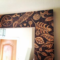 Pyrography mirror frame home decor. Floral design burned into the wood