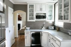 Gray walls, white cabinets, tile backsplash--love it all, especially in this smaller kitchen space!