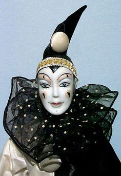 Court jester porcelain doll - Silver casket.