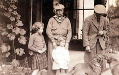 Princess Elizabeth (later Queen Elizabeth II) with her father, The Duke of York (later King George VI), her uncle King Edward VIII (later The Duke of Windsor), and her sister, Princess Margaret.