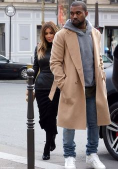 Kim Kardashian & Kanye West, love this jacket! Nothing sexier than a man with good jackets!