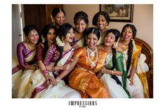 South Indian bride. Temple jewelry. Jhumkis.Orange silk kanchipuram sari.Braid with fresh jasmine flowers. Bridesmaids saris.Tamil bride. Telugu bride. Kannada bride. Hindu bride. Malayalee bride.Kerala bride.South Indian wedding.