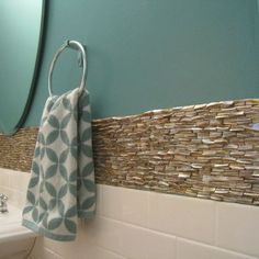Guest bath - maybe get a towel with a pattern on it for the half bath by the front door - and matching soap dispenser