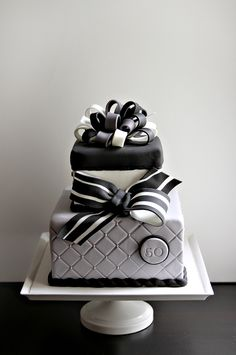 Modern Birthday Cake.    http://couturecakery.net/2013/02/17/happy-50th-birthday-tom/