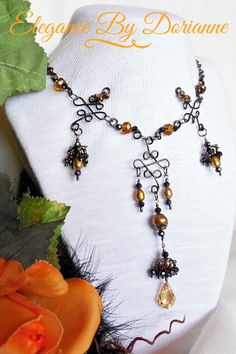 Sumptuous Gothic Victorian Necklace, created with luxurious gold pearls and crystals, lavish gunmetal crystal tassels, and finished with a Brilliant Gold Swarovski Baroque Pendant! #gothicvictoriannecklace #gothicvictorianjewelry #gothicvictorian #gothicjewelry #gothicnecklace #gothicfashion #gothicstyle #victoriangothicjewelry #victoriangothicnecklace #victoriangothic #victorianstyle #victorianjewelry #etsyjewelry #etsyjewelryshop #etsy #etsyjewelrydesigner #elegancebydorianne #pearlnecklace Victorian Jewelry, Victorian Gothic, Gothic Jewelry, Etsy Jewelry, Handmade Jewelry, Etsy Handmade, Jewelry Gifts, Jewellery, Gifts For Women