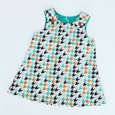 A personal favorite from my Etsy shop https://www.etsy.com/listing/522814646/teal-and-brown-houndstooth-toddler-dress