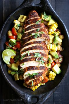 Spice rubbed chicken breasts served with a flavorful chickpea salad with fresh corn, tomatoes, avocado and lime juice – a quick and easy weeknight dish!