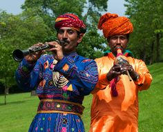 Indian musicians   Two members of the Jaipur KAWA Brass Band tuning up at the Mela in Kelvingrove Park.  On the left is the Indian clarinet and on the right the poonga, a traditional Indian woodwind instrument used in folk music in the Rajasthan state of India. This instrument is also used by Kalbelia tribe in that area during the catching of snakes.    Team - www.visitheritageindia.com