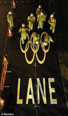 The Olympic rings appear on a busy street to show where members of the public are not allowed to drive during the games