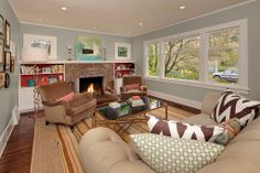 Living room inspiration... I like the hardwood and the walls with white trim.