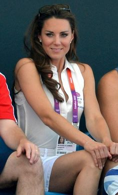Catherine, Duchess of Cambridge, claps while attending the women's field hockey competition at the 2012 London Summer Olympic Games.