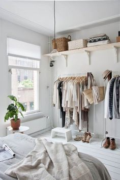 I love the clothing and wall shelving, the white floor boards and the cute hanging light bulb!