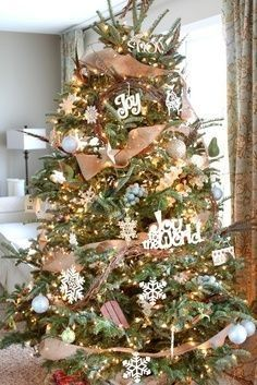 Christmas Tree - love the natural burlap with white snowflakes and phrases