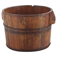 "Wood bucket with wrought iron hardware and a warmly weathered finish.   Product: BucketConstruction Material: WoodColor: NaturalDimensions: 12"" H x 15"" Diameter"