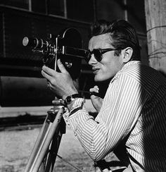 "James Dean with his Bolex camera on location for ""Giant"" in Marfa, Texas, 1955.  Modern silver gelatin, 14x11, signed.  Modern silver gelatin, 20x16, signed.  © 1978 Sid Avery  MPTV"