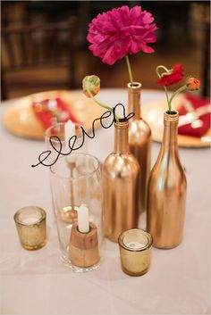 Gold wedding ideas: Gold bottles with wire table numbers @weddingchicks