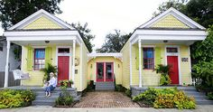 what a neat idea!  Buy two shotgun houses next door to each other and connect them with a common living area.