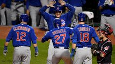 CLEVELAND, OH - NOVEMBER 01: Addison Russell #27 of the Chicago Cubs celebrates with Anthony Rizzo #44, Ben Zobrist #18 and Kyle Schwarber #12 after hitting a grand slam home run during the third inning against the Cleveland Indians in Game Six of the 2016 World Series at Progressive Field on November 1, 2016 in Cleveland, Ohio. (Photo by Jason Miller/Getty Images)