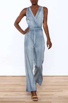 Chambray sleevelessjumpsuit. Top has a v-neckline and is detached at the back with zipper closure. Straight cut bottom with hidden zipper closure and fitted on waist.   Chambray Jumpsuit by Hommage. Clothing - Jumpsuits & Rompers - Jumpsuits New York City Manhattan, New York City