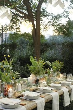 such a beautiful table setting. and i'll take that chunky rustic table too. looks like an old door