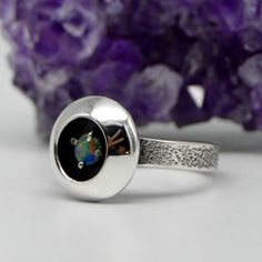 This ring features a prong-set Australian Opal, nestled within an open dome that has been brought to a high polish. size star-studded textured band sterling silver stamped with maker's mark Australian Opal, Prong Set, Makers Mark, Polish, Band, Star, Sterling Silver, Rings, Jewelry