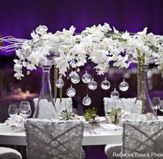 a raised centerpiece for head vineyard table either by plexi stand we own or other prop.