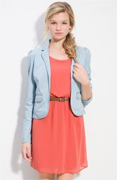 Wear a chambray blazer over an orange dress and put on turquoise shoes!