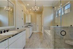 Custom chandelier lighting with granite countertops & bronze fixtures.