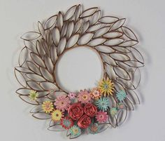 s 15 fabulous spring wreath ideas that ll make your neighbors smile, Don t Toss Those Toilet Paper Rolls