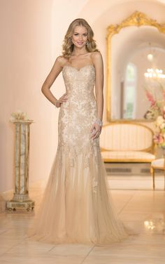 This vintage lace wedding dress is the best of both worlds - a fashion-forward silhouette with vintage-inspired details. See why Stella York is right for your big day!