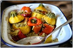 Stuffed yellow courgettes and red peppers