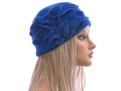 Artsy handmade womens winter hat / cap in cobalt blue / soft boiled wool / size M - strtched up to L-XL / with leaves at the side. $64.00, via Etsy.