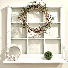 A beautiful window shelf created from an old window.