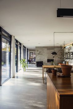 Concrete floors that extend outside, floor to ceiling windows with metal frames, concrete divider wall. Love.