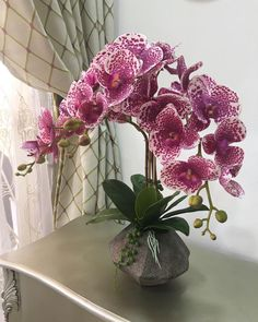 ~ Pin en cayiorquidias ~ 3 stalks Exotic combo purple white displayed in stone vase with octagon shape. Great for entrance hall console or… Silk Orchids, Orchids Garden, Phalaenopsis Orchid, Purple Orchids, Orchid Plants, Luxury Flowers, Exotic Flowers, Beautiful Flowers, Orchid Flower Arrangements