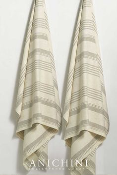 Loomed from 100% natural linen, the Olga Towels and bath linens are a flatweave linen towel accented with traditional variegated natural stripes on an ivory background. Linen towels are the best towels for you and the environment. They're eco-friendly, rejuvenate your skin, don't acquire smells, and last forever! #luxurybathroomdecor#modernrusticbathroomdecor #modernrusticbathroom #linenbathtowels #farmhousebathroom