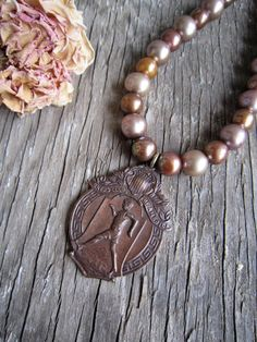1914 Walkers  Club of America award medal on pearl by susanruppel1, $118.00  #vintage recycled necklace # vintage medal necklace #vintage walking club medal  #brown pearl necklace #susan ruppel designs