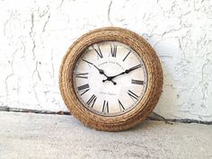 This would be so easy to DIY! Buy some seagrass rope (?) and glue onto cheap clock.