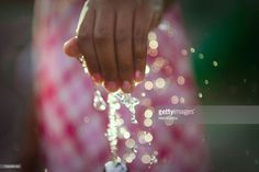 Play at the public water fountain. girl's hand in the wather.raise a spray of water.wather effect the light and make bokeh. summer image.Only the left hand and raise a spray of water and bokeh.#GettyImages.RM.#MamiGibbs